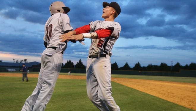Stewarts Creek's Cole Harrison (10) and Dylan Burney (5) celebrate their win over Houston with a body slam after game 4 of Class AAA Baseball Tournament during Spring Fling on Tuesday, May 23, 2017. Final score was 10 to 0.