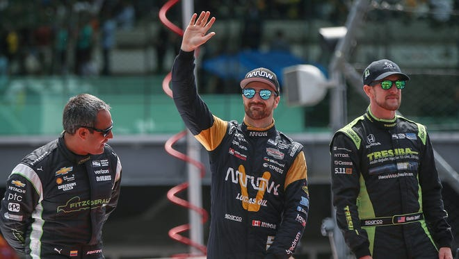From left, IndyCar drivers Juan Pablo Montoya, James Hinchcliffe and Charlie Kimball are introduced before the start of the 101st running of the Indianapolis 500 at Indianapolis Motor Speedway, Sunday, May 28, 2017.