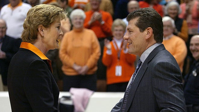 Tennessee coach Pat Summitt, left, shakes hand with Connecticut coach Geno Auriemma before their women's college basketball  game in this Jan. 7, 2006 file photo in Knoxville, Tenn. The two schools meet against this weekend.
