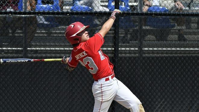New Jersey's Chris Cartnick (23) rips a grand slam during the Eastern Regional Little League Tournament in Bristol Wednesday afternoon.
