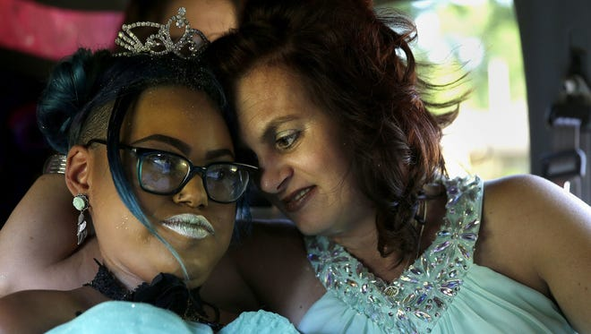 Jerika Bolen and her mother, Jen, share a moment on the way to a July 2016 prom in Appleton, Wis. Jerika died in September 2016, after she decided to end treatment for an incurable genetic disease.
