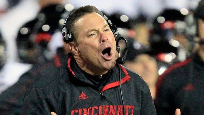 Cincinnati head coach Butch Jones yells to his team in the first half of a game against Miami (Ohio) on Oct. 6, 2012, in Cincinnati.