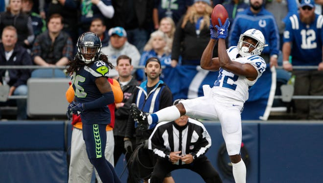 Indianapolis Colts defensive back Kenny Moore (42) jumps to catch a punt and toss it back to teammates against the Seattle Seahawks at CenturyLink Field in Seattle on Sunday, Oct. 1, 2017.
