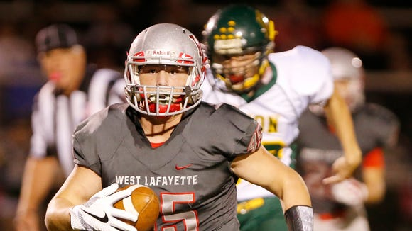 Joey Kidwell of West Lafayette returns an interception