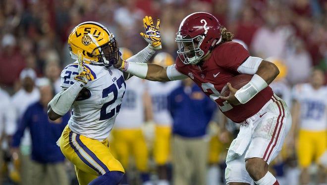 Alabama quarterback Jalen Hurts (2) stiff arms LSU linebacker Corey Thompson (23) in second half action at Bryant Denny Stadium in Tuscaloosa, Ala. on Saturday November 4, 2017. (Mickey Welsh / Montgomery Advertiser)