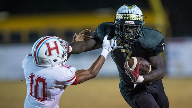 Wetumpka running back Kavosiey Smoke (7) breaks the tackle of Hillcrest's Joshua Mullins (10) in first half action at Hohenberg Field in Wetumpka, Ala. on Friday December 1, 2017.