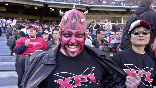 San Francisco Demons fan Mark Looney, from Pleasant Hill, Calif., shows off his XFL shirt during the first quarter against the Los Angeles Xtreme, Sunday, Feb. 4, 2001 in San Francisco in their first XFL game.