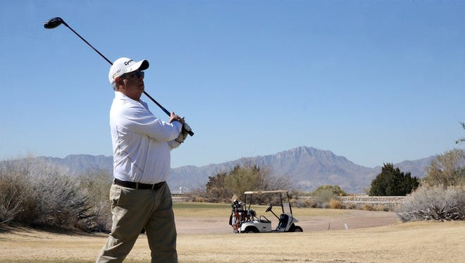 "Robert Martinez watches his tee shot during a February golf outing at the Butterfield Trail Golf Club in East El Paso. Martinez says the 18-hole course, owned and operated by the El Paso airport, is ""beautiful."""