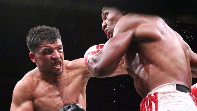 Victor Ortiz, left, lands a punch to Devon Alexander during their fight on Feb. 17. Ortiz will fight against Sept. 30 in Ontario, Calif.