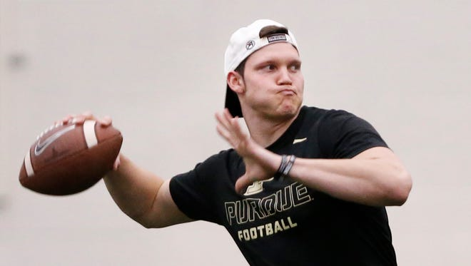 Quartrback Elijah Sindelar throws the before before the start of Purdue spring football practice Wednesday, March 21, 2018, inside the Mollenkopf Athletic Center.