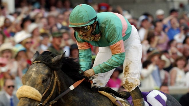 Jockey Mike Smith reacts aboard Giacomo after they won the 13st Kentucky Derby Saturday, May 7, 2005 at Churchill Downs in Louisville, Ky. Giacomo pulled off the second-biggest upset in derby history and now heads to Baltimore for next Saturday's Preakness Stakes, the second leg of the Triple Crown.
