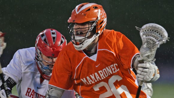 Mamaroneck's Peter Conley is pursued by North Rockland's Danny Moore during the Section 1 Class A boys lacrosse championship game at White Plains High School May 24, 2013.
