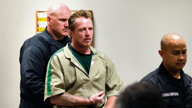 FILE - In this Aug. 11, 2014 file photo, Nicholas Sheley is escorted into the Whiteside County courtroom in Morrison, Ill., for sentencing in the murder of four people in a northwest Illinois apartment in the June 2008. Sheley who is serving life sentences for each of six summertime 2008 killings in Illinois next will face trial in Missouri on charges he killed an Arkansas couple during the spree. (AP Photo/The Telegraph, Alex T. Paschal, Pool, File)