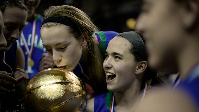 Green Bay Notre Dame's Olivia Campbell kisses the championship trophy after the Tritons defeated DeForest in the Division 2 state championship game.