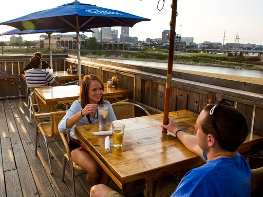 Becca Gregg, 21, and Nate Crane, 21, both of Des Moines, have drinks on the patio Tuesday, Aug. 13, 2013, at Mullets in Des Moines.