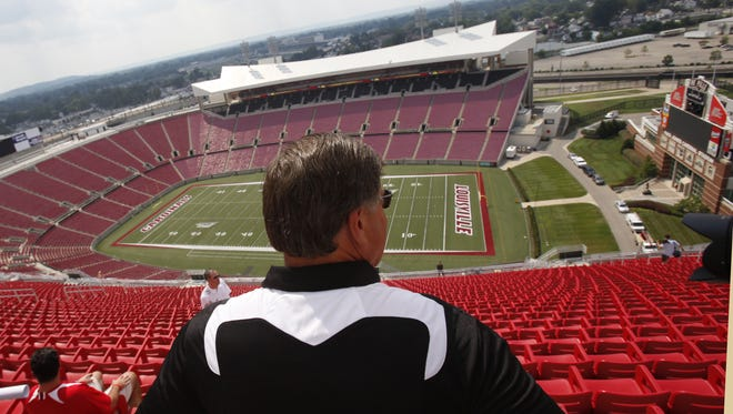 Athletic director Tom Jurich looks out over Papa John's Cardinal Stadium from the new upper section, known as the UPS Flight Deck. (By Pam Spaulding, The Courier-Journal) August 18, 2010