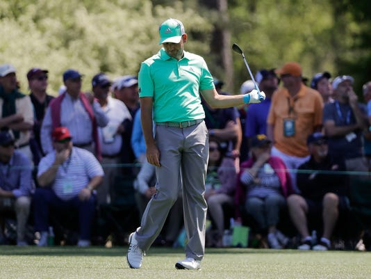 Sergio Garcia, of Spain, reacts on the 15th hole during the first round at the Masters golf tournament Thursday, April 5, 2018, in Augusta, Ga. Garcia shot an 8-over 13 on the hole. (AP Photo/David J. Phillip)