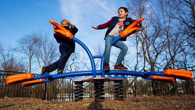 Jayden Day, left, and Raiden Naickilath play on the playground at Douglas Park in Springfield Wednesday, Nov. 18, 2020. The Springfield Park District board voted Wednesday to rename the near north side park after Otis B. Duncan, the highest-ranking Black officer to serve in the American Expeditionary Forces in Europe during World War I. Duncan is buried at Camp Butler National Cemetery.
