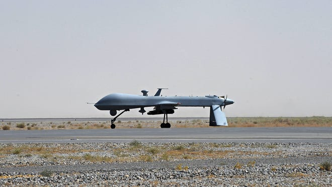 A U.S. Predator unmanned drone armed with a missile stands on the tarmac of Kandahar military airport in Afghanistan. It is used to hunt al-Qaida targets from Pakistan to Afghanistan.