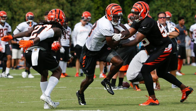A.J. Green splits the Bengals defense during training camp on July 30 outside of Paul Brown Stadium.