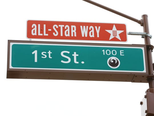 """Mayor Greg Stanton and Mercury guard Diana Taurasi unveiled the new """"All-Star Way"""" street sign at 1st St. and Jefferson, next to US Airways Center."""