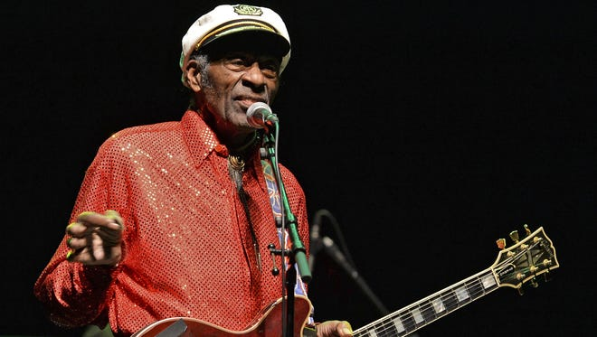 """(FILES) This file photo taken on April 15, 2013 shows legendary US singer and composer Chuck Berry, one of the pioneers of rock-and-roll, performing at a concert in Montevideo. Days after he died at age 90, a new song came out on March 22, 2017 from Chuck Berry driven by the sort of rollicking guitar riffs that created rock 'n' roll.""""Big Boys"""" is the first song from the rock pioneer's """"Chuck,"""" his first studio album in nearly 40 years. His label said the album will come out on June 16. The first single starts with a signature Chuck Berry guitar solo with echoes of his legendary hit """"Johnny B. Goode"""" -- an electric bolt of energy that seamlessly marries blues and country music. / AFP PHOTO / PABLO PORCIUNCULAPABLO PORCIUNCULA/AFP/Getty Images ORIG FILE ID: AFP_MW1YT"""