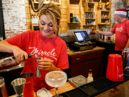 Ashley Tate, a mixologist at Missouri Spirits, makes a Christmapolitan cocktail during a sneak peak of the Miracle on Walnut event in the tasting room of the distillery on Tuesday, July 25, 2017.  Child Advocacy Center is bringing the popular holiday pop-up bar back this year, with two Springfield venues.