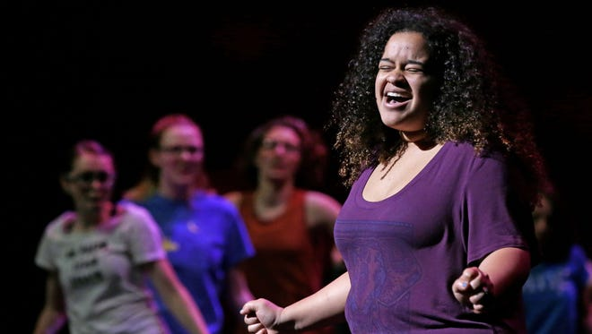 Liz Valentin of Green Bay West High School sings during the opening number as students go through a rehearsal Saturday afternoon in advance of Saturday night's Center Stage High School Musical Theater Awards at the Fox Cities Performing Arts Center in Appleton.