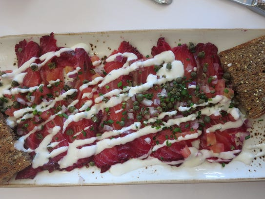 A generous platter of house-made beet-cured lox is