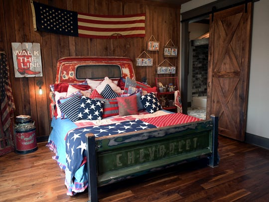 The downstairs boy's bedroom in this home built by Wiesner Homes has a bed made from an old Chevy pickup truck frame.
