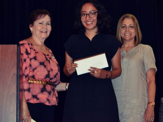 Port St. Lucie High School scholarship recipient Xiomara Martinez, alongside PART's scholarship representatives