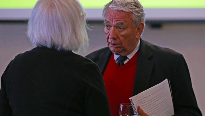 Former Governor Tommy Thompson mingles with people during the 10th anniversary celebration of the Wisconsin Institute for Public Policy and Service.