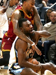 Memphis Grizzlies Tony Allen is fouled by Cleveland Cavaliers Jordan McRae.