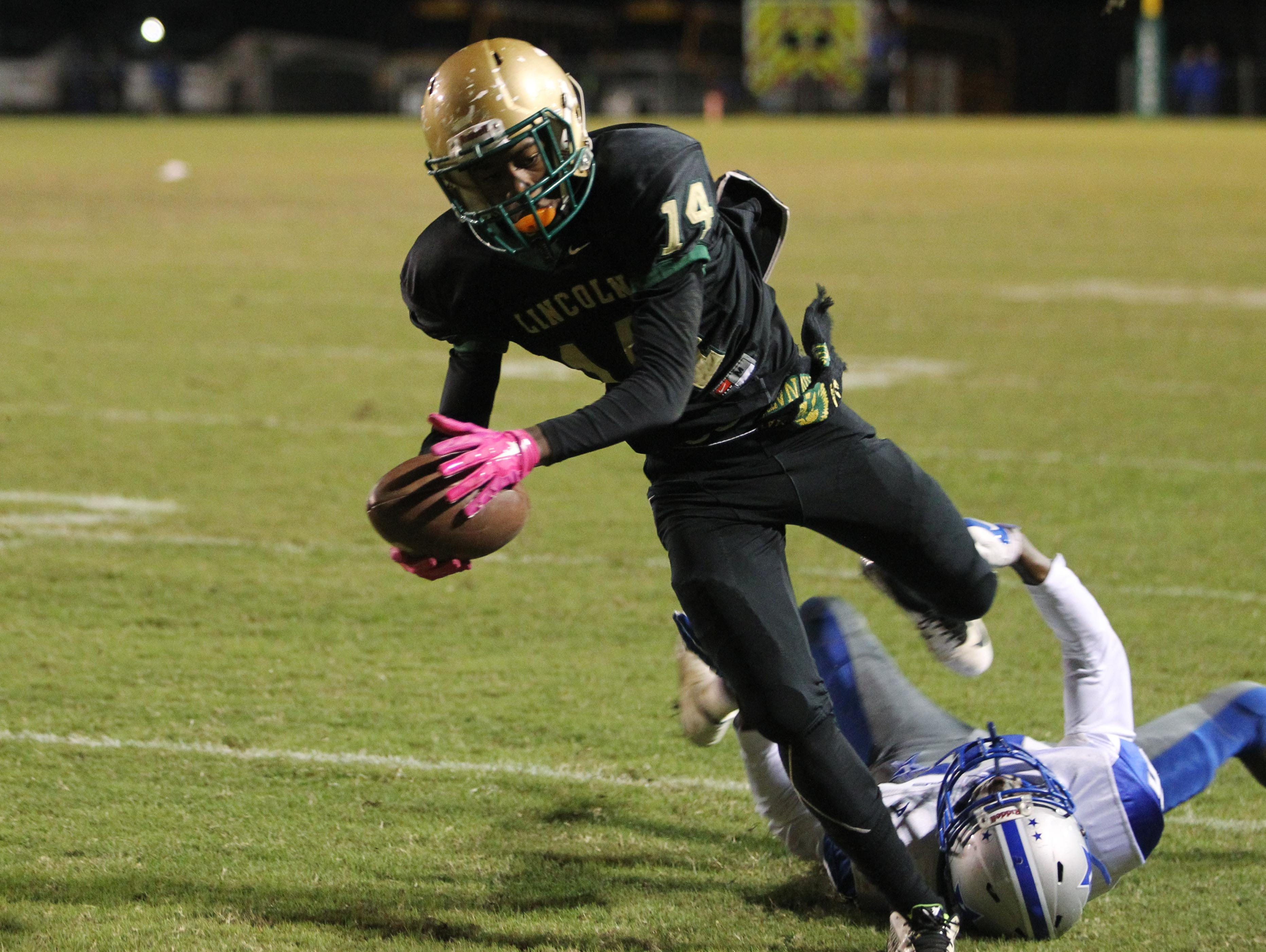 Lincoln junior Marquel Pittman caught three passes for 94 yards and a 19-yard touchdown, while also returning a kickoff 75 yards for a touchdown to help the Trojans get past Lee, 44-41 in overtime on Friday night in a Region 1-7A quarterfinal playoff game.