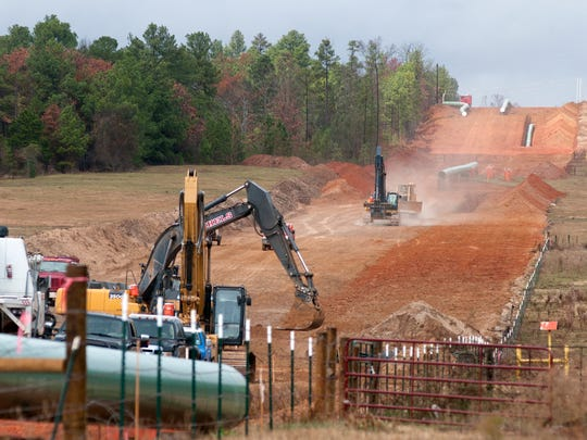Crews work on construction of the TransCanada Keystone XL pipeline near Winona, Texas, in 2012. <240><131><240><8,3><cutline_credit>AP file Photo/The Tyler Morning Telegraph, Sarah A. Miller<240><240></cutline_credit>