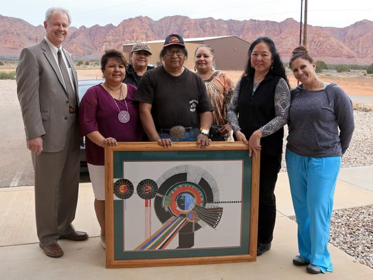 Artist Daniel Growler, center, poses with elected officials