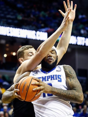Memphis forward Mike Parks Jr. (right) is fouled by UCF defender Rokas Ulvydas (left) during the second half Sunday.