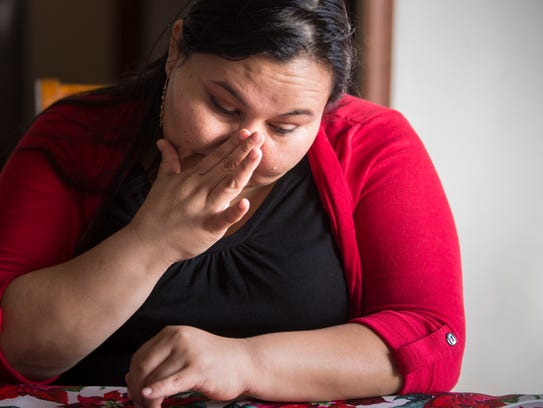 Marielda Moreno, 32, cries as she talks about the father