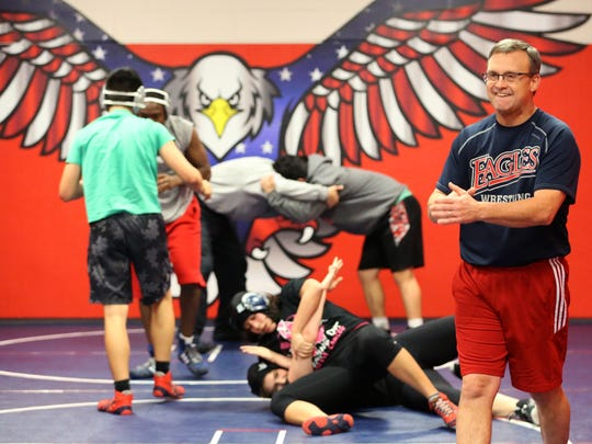 Veterans Memorial High School wrestling coach Ed Arvin coaches his team the night before they head to the state wrestling meet on Wednesday, February 22, 2017.