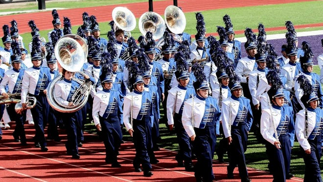 The Carlsbad Marching Band marches onto the field for competition in Pecos, Texas, on Oct. 10.