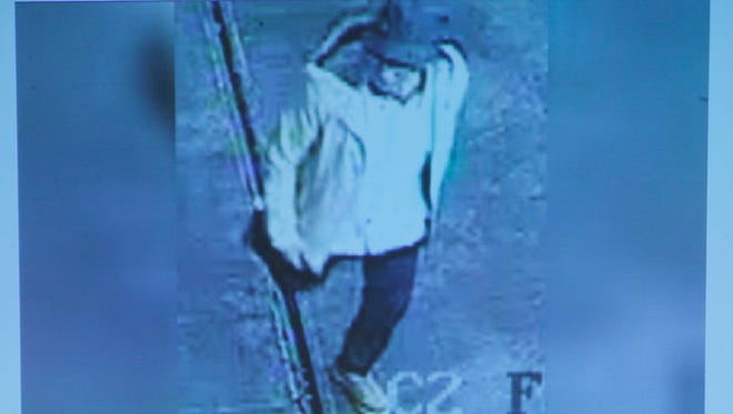 A photo presented by Belgian federal prosecutors shows a suspect wanted in connection with the Brussels attacks of March 22.