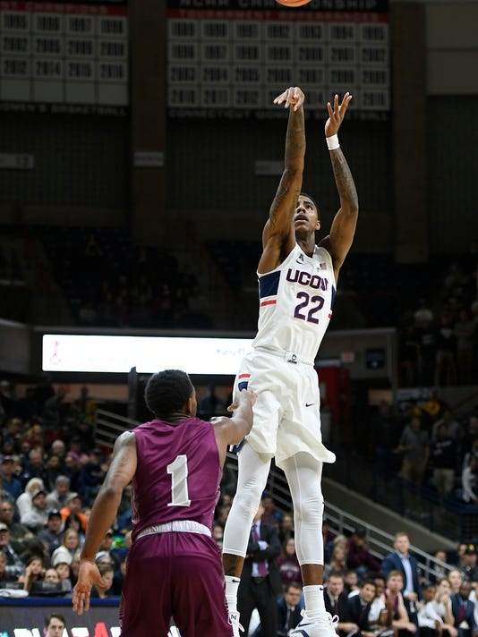Connecticut's Terry Larrier shoots a basket over Colgate's Jordan Burns during the second half of an NCAA college basketball game, Friday, Nov. 10, 2017, in Storrs, Conn. (AP Photo/Jessica Hill)