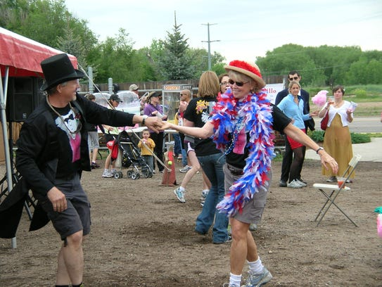 Noreen Houska, dancing here at the HouskaHouska race in 2009, has helped underprivileged children by providing a basic necessity: underwear.