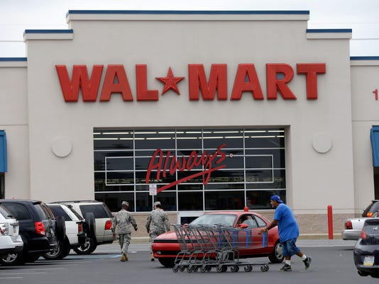 Three arrested in Wal-Mart protests that extend to 15 cities