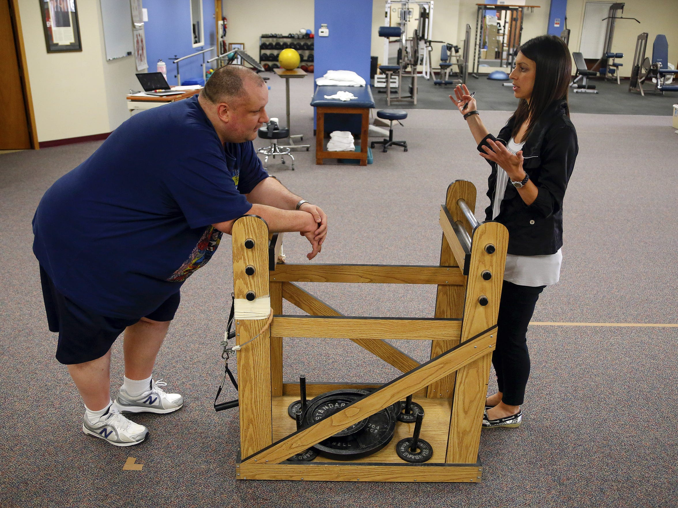 Physical Therapist Stefanie Kirk works with Register Columnist Daniel Finney Tuesday, June 16, 2015.