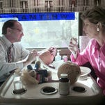 In this Friday, Oct. 31, 1997, file photo, New Jersey Gov. Christie Whitman, right, eats a pita sandwich as her husband John draws a face on a pumpkin while they travel on Whitman's re-election bus near Orange, N.J. John Whitman, died Thursday at Morristown Medical Center. He was 71.