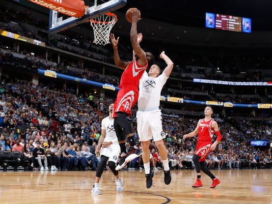Houston Rockets guard James Harden, left, is fouled as he makes a basket by Denver Nuggets center Mason Plumlee in the first half of an NBA basketball game Saturday, March 18, 2017, in Denver. (AP Photo/David Zalubowski)