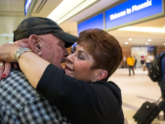 Marie Ginan (right) and Gregg D'Agostino see each other for the first time in over 51 years, February 12, 2015, at Sky Harbor International Airport, Phoenix.