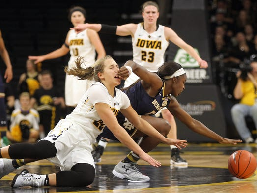Iowa's Kathleen Doyle gets hit in the face as she fights