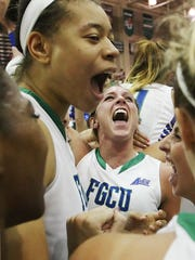 FGCU's Jenna Cobb, center, celebrates with teammates after beating Stetson in the Atlantic Sun Basketall Championship at Alico Arena last March. Cobb was named the tournament most valuable player.